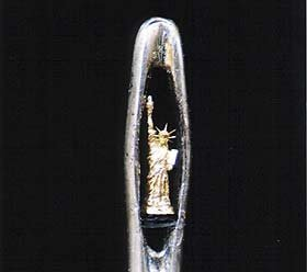 The Statue of Liberty in the eye of a needle